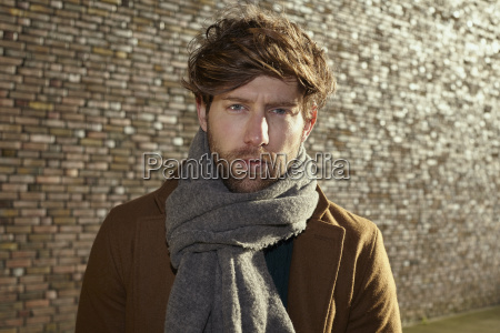 portrait of young man with scarf