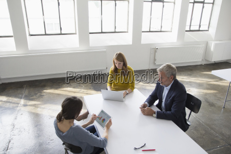 businessman and two women in conference