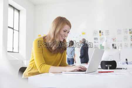 smiling young woman in office at