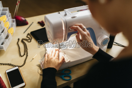 young fashion designer working in her