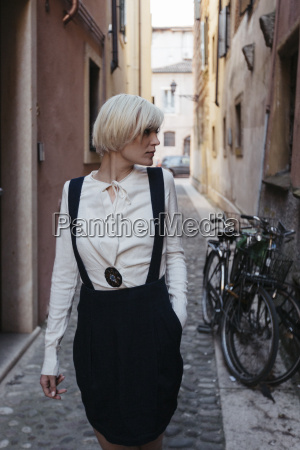 italy verona fashionable blond woman standing
