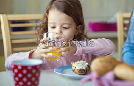 portrait of little girl drinking glass