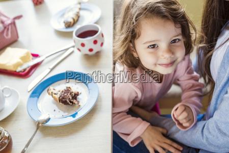 portrait of smiling little girl cuddling