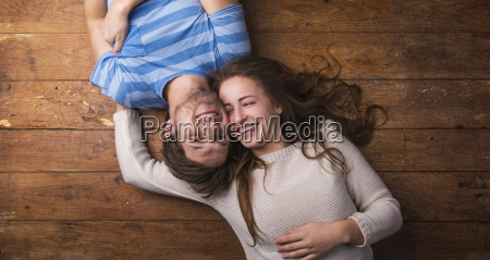 laughing young couple relaxing together on