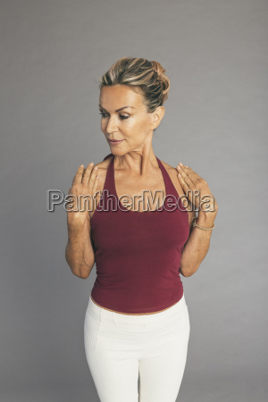 mature woman flexibility exercise arms ellbow
