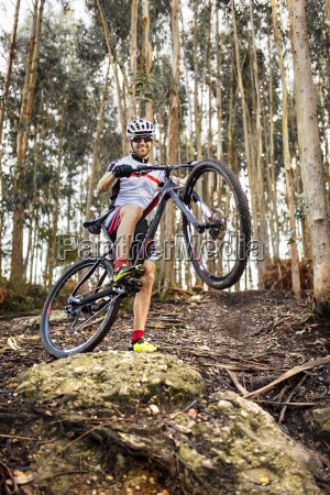 smiling mountain biker in the forest