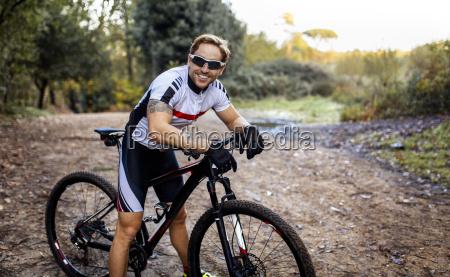 portrait of smiling mountain biker driving