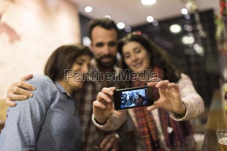three friends taking selfie in a