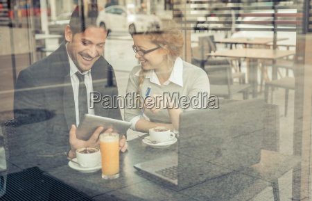 two smiling business partners sitting in