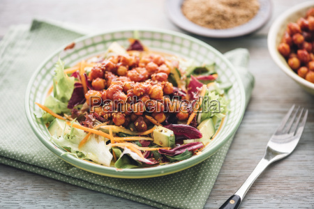mixed raw salad with marinated tomato