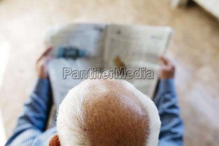 head of senior man reading