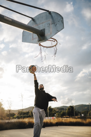 young man playing basketball on an
