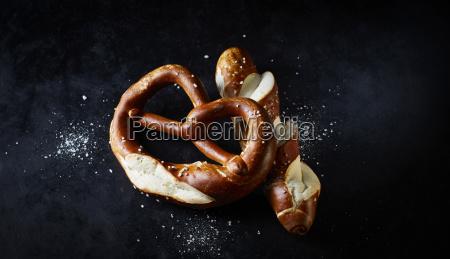 pretzel and pretzel roll on dark