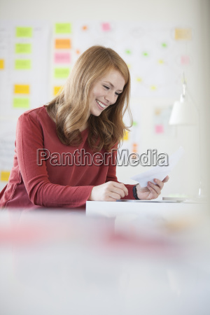 young woman in office working at
