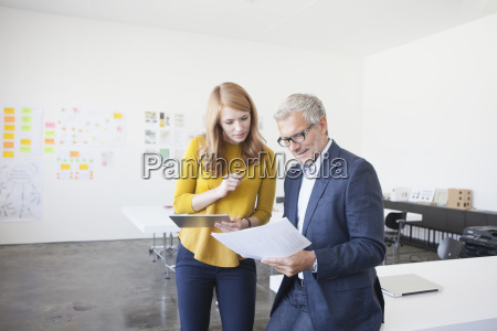 businessman and coworker in office studying