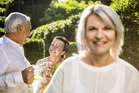 man and woman in garden with