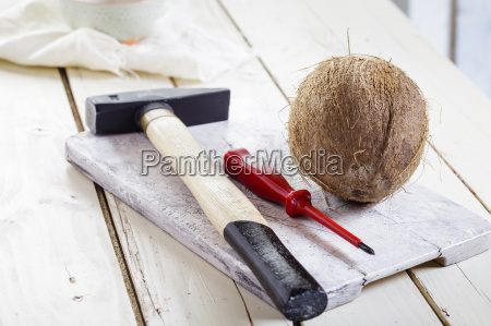 hammer screw driver and coconut on