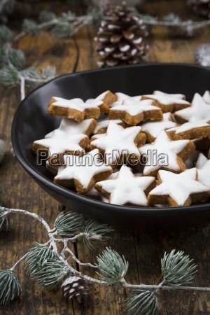cinnamon stars in bowl and christmas