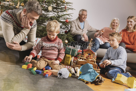 three genarations family celebrating christmas children