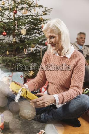 senior woman looking at christmas present