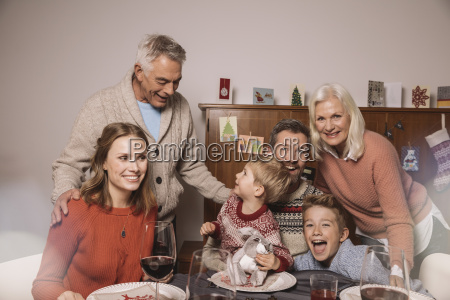 happy family of three generations during