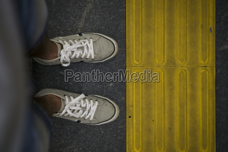 feet of a man standing in