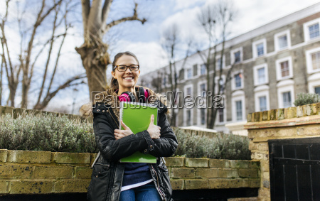 london student girl with headphone and