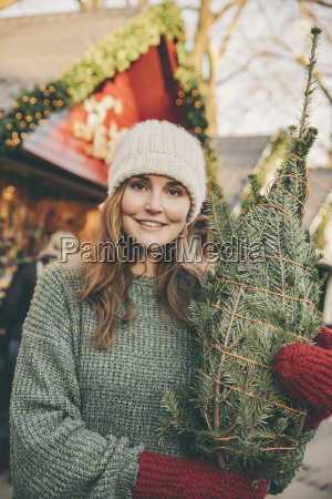 smiling woman with a wrapped up