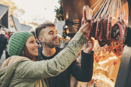 couple looking at gingerbread hearts on