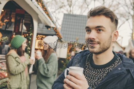 man having a hot punch on