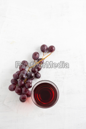 glass of grape juice and red