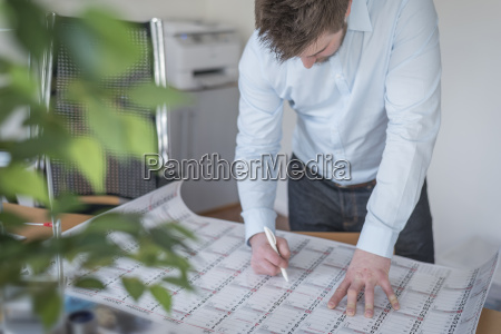 young man in office looking at