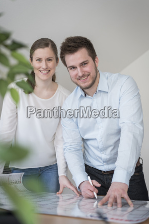 smiling young man and woman in