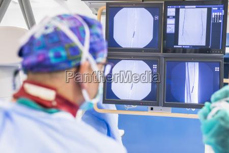 radiologist looking at x ray image