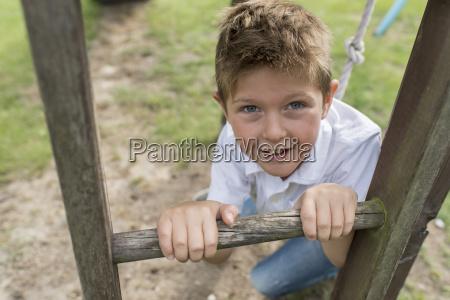 portrait of little boy climbingon a