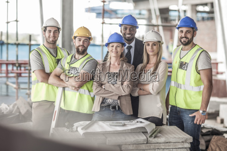 portrait of confident construction workers and