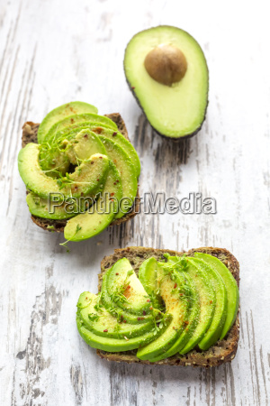 protein bread garnished with sliced avocado