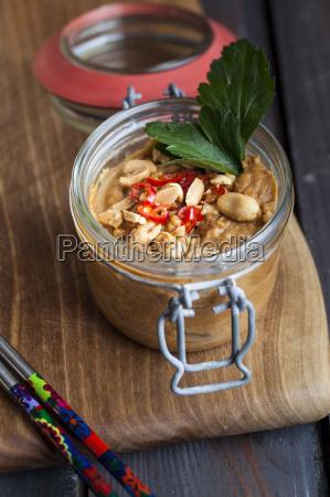 preserving jar of peanut chili dip