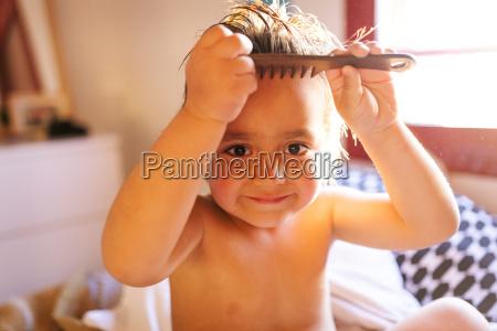 portrait of little boy brushing his