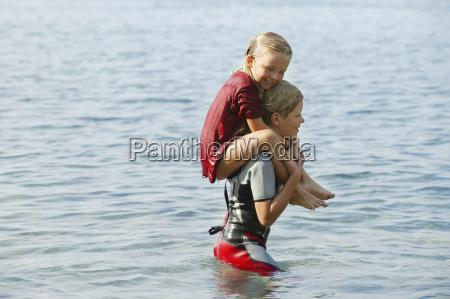 spain mallorca boy carring little sister