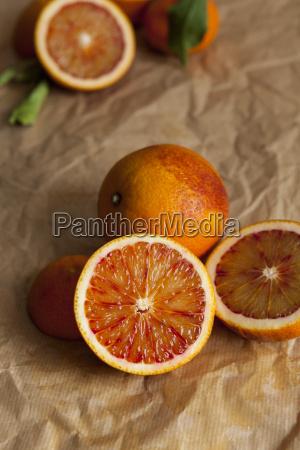 whole and sliced blood orange on
