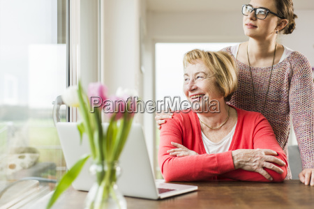 smiling young woman with senior woman