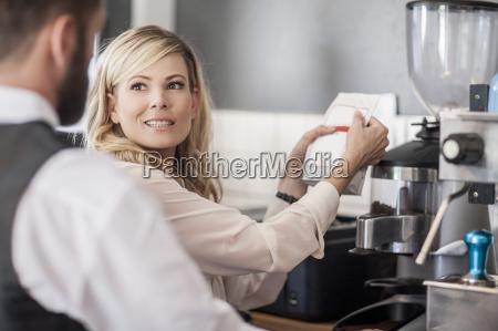 restaurant staff at coffee bar preparing