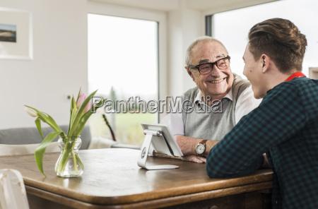 happy senior man and his grandson