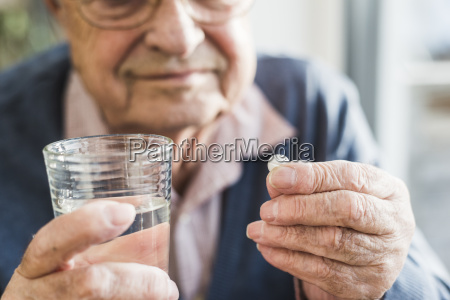 hands of senior man holding tablet