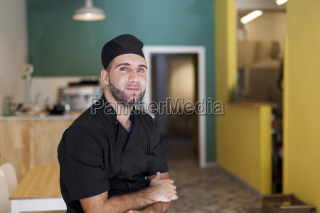 mid adult chef sitting in his