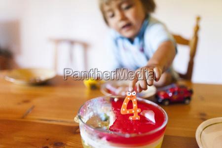 little boy celebrating his fourth birthday