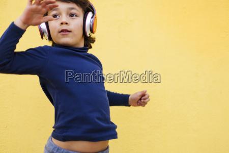 dancing little boy in front of