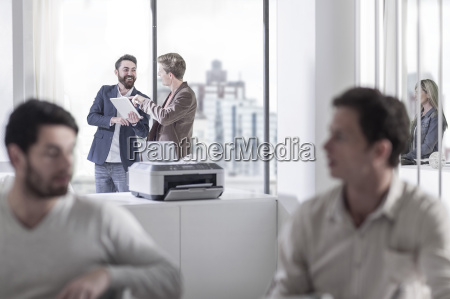 smiling man in office with digital