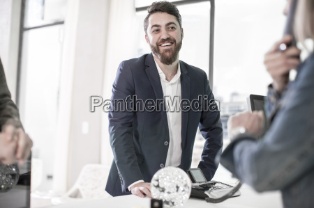 smiling businessman at office reception